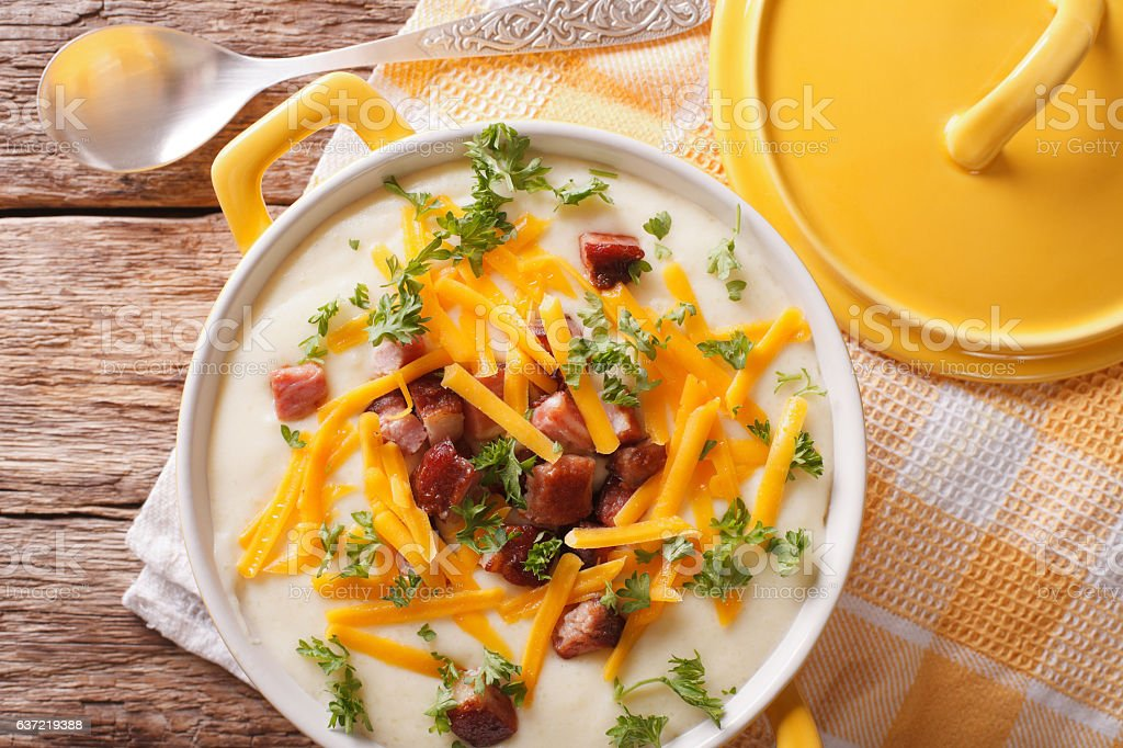 Tasty thick potato soup with bacon and cheddar cheese. horizontal stock photo