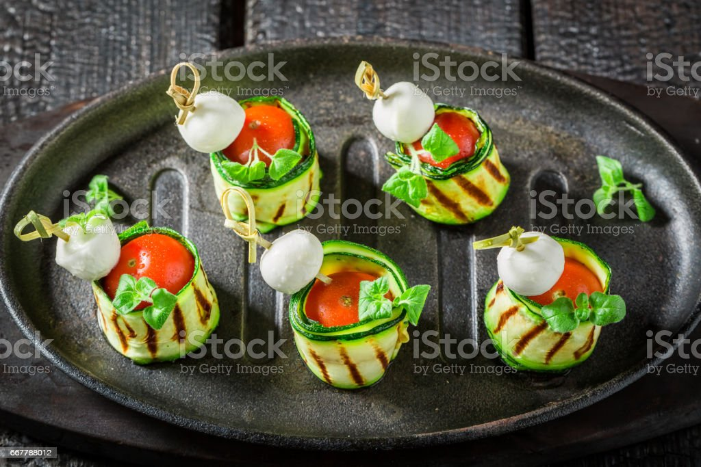 Tasty various finger food with vegetables and herbs for party stock photo