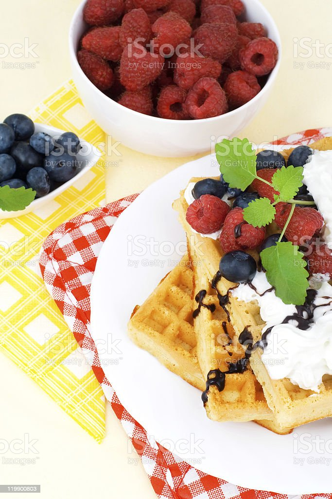 Tasty waffles with summery fruits royalty-free stock photo