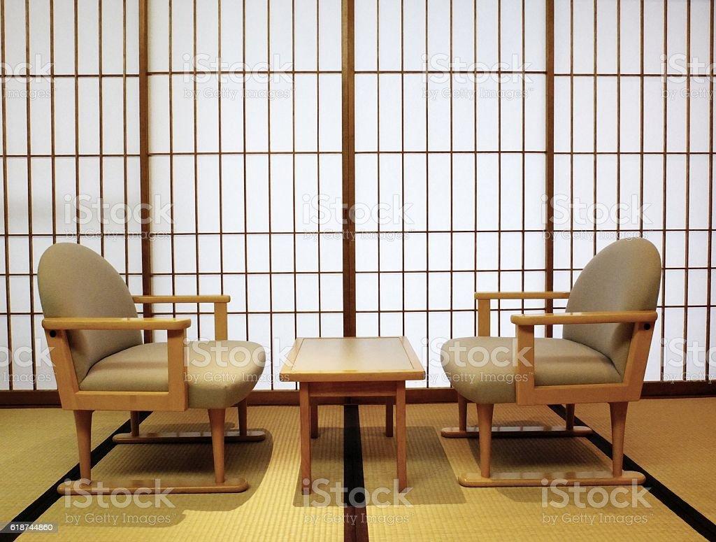 Tatami, shoji sliding doors, table and chairs stock photo