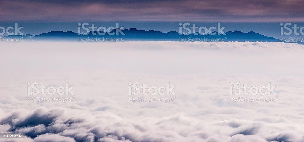Tatras mountain range above Misty from Mala Fatra stock photo