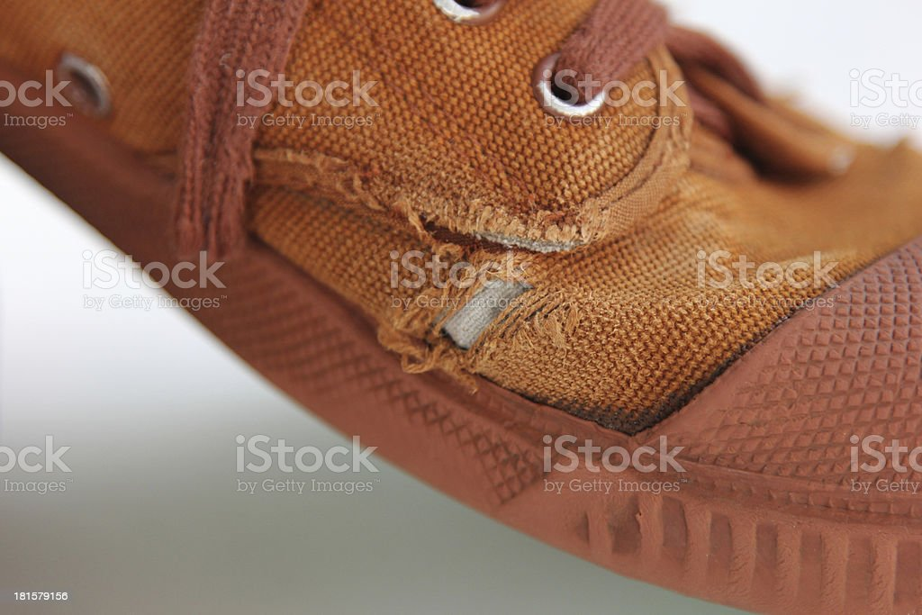 Tatter hole on canvas brown shoe royalty-free stock photo
