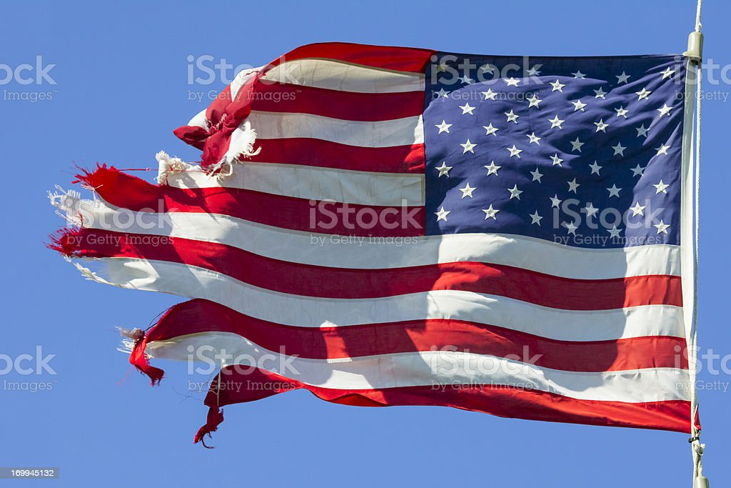 Tattered American Flag, Still Flying Free and Proud stock photo
