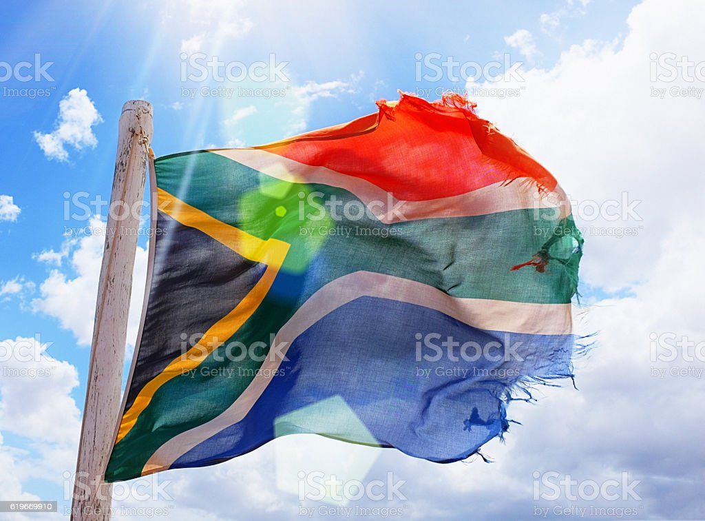 Tattered South African flag, still flying despite difficulties stock photo