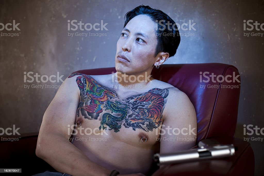 Tattoed Gangster with gun stock photo