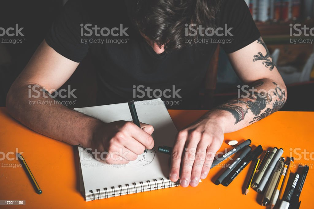 Tattoo Artist Drawing stock photo