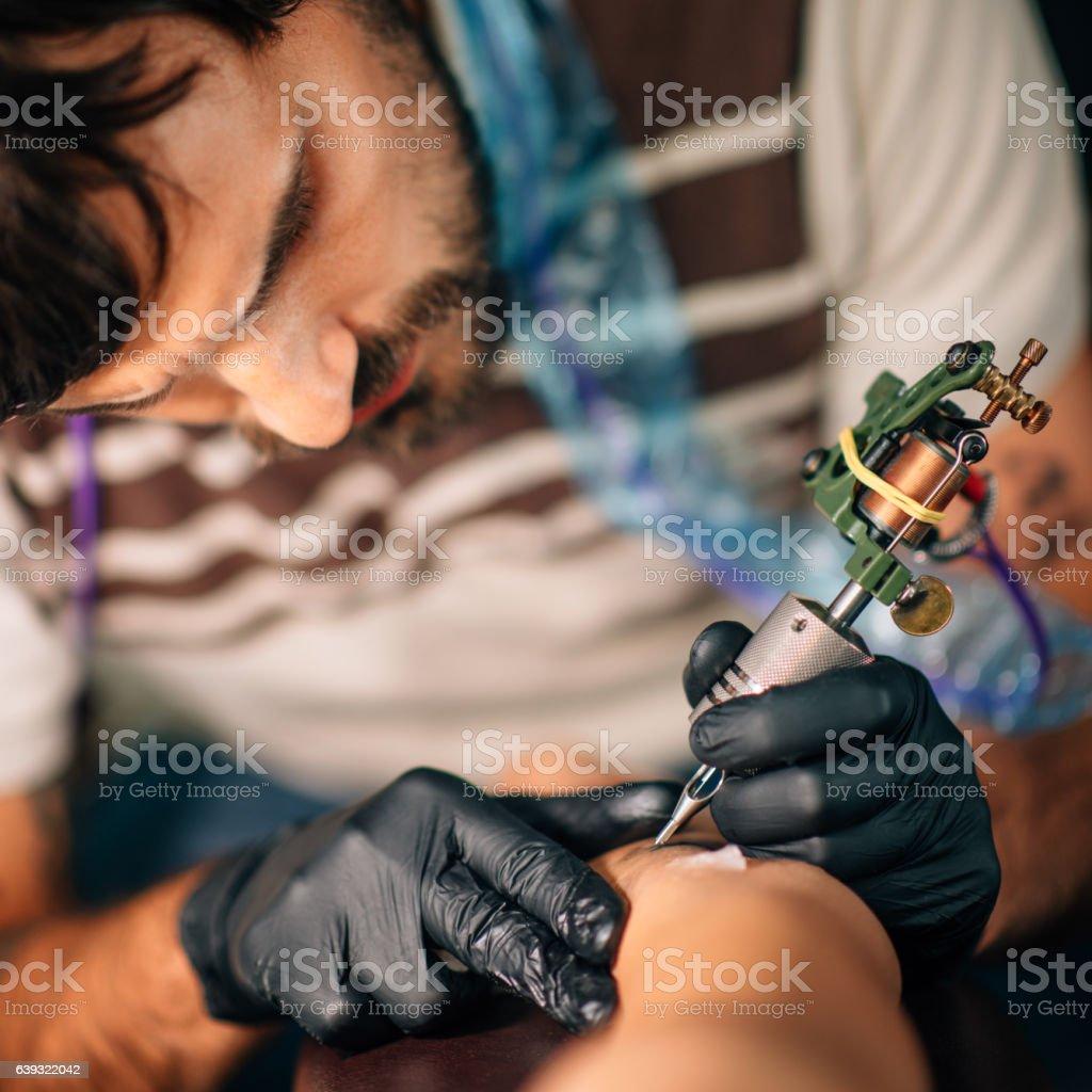 Tattoo artist stock photo