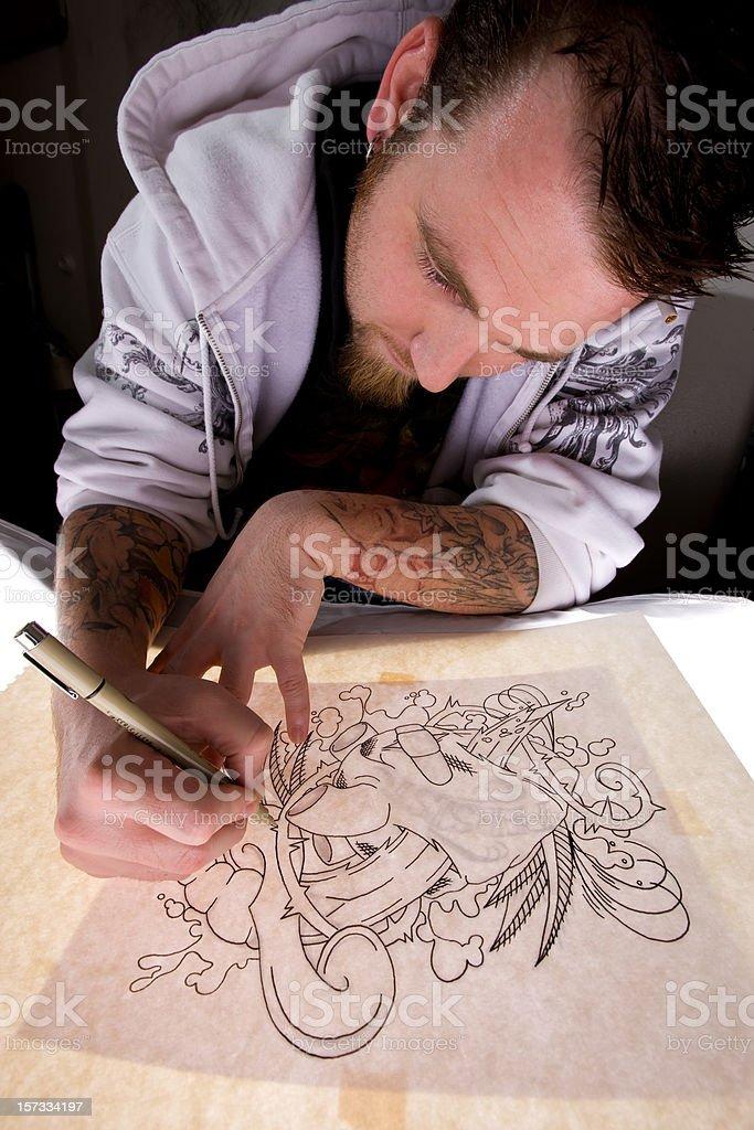 Tattoo Artist Tracing Design royalty-free stock photo
