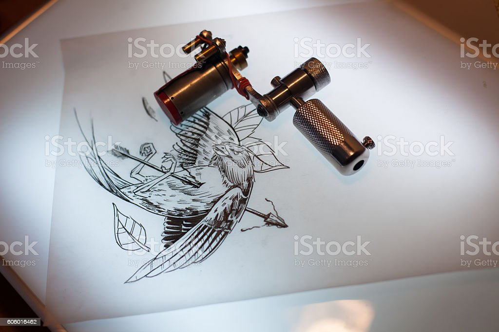 Tattoo equipment and scetch stock photo