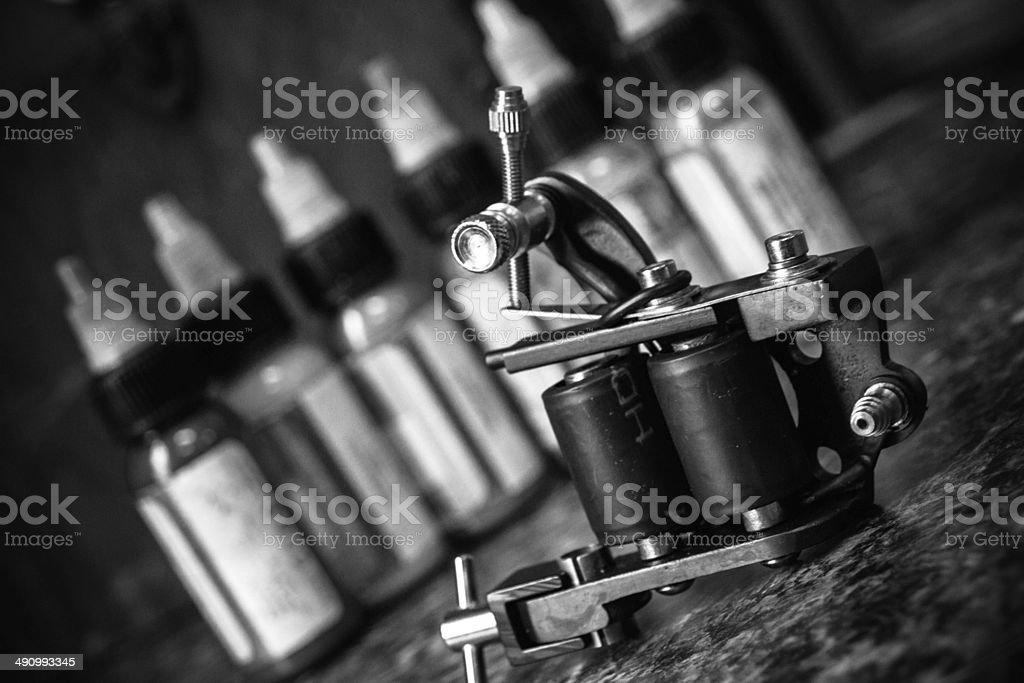 Tattoo Machine and Ink Bottles stock photo