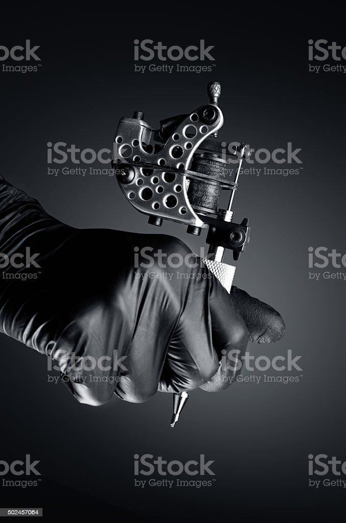 Tattoo Machine concept dark stock photo