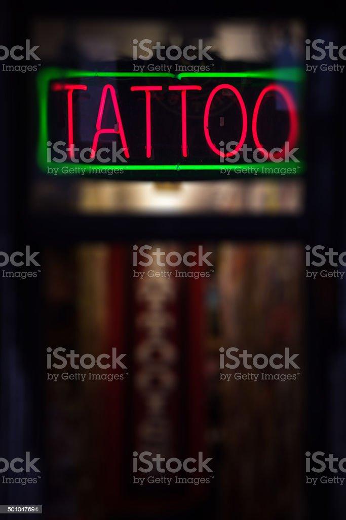 Tattoo neon sign stock photo
