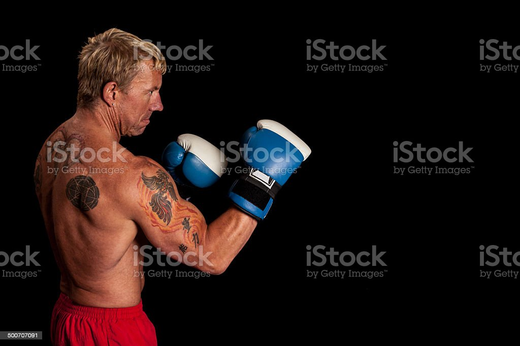 Tattooed Boxer with Gloves Up stock photo