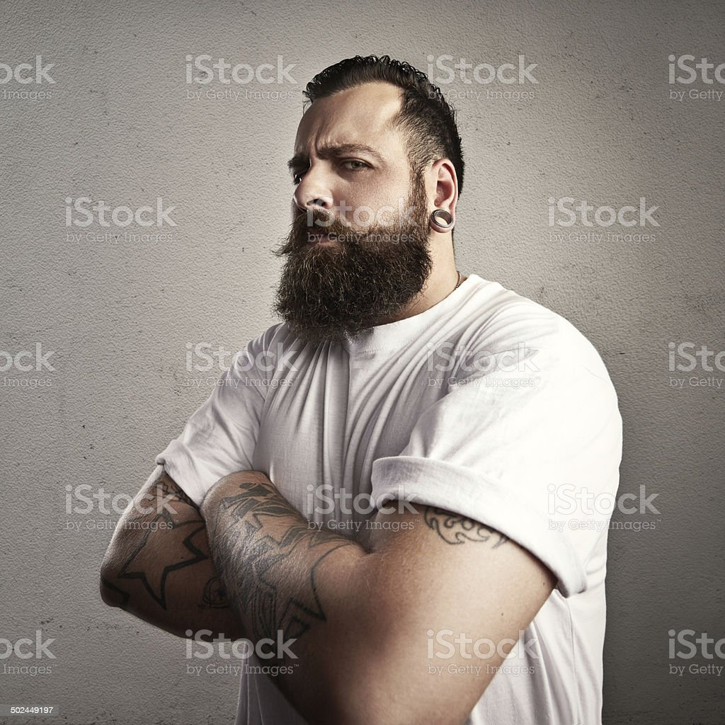 Tattooed brutal man wearing white t-shirt stock photo