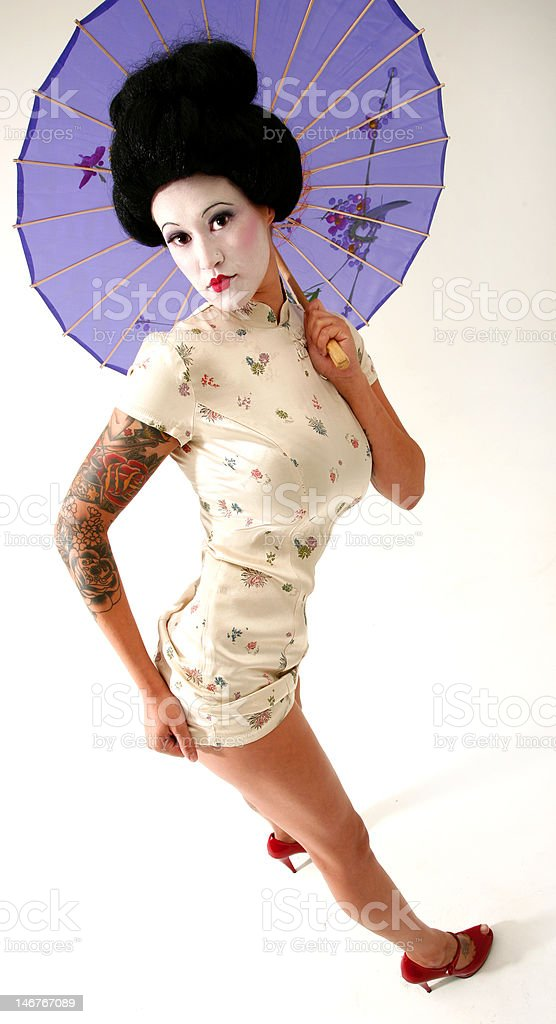 Tattooed Geisha with parasol umbrella in tight kimono skirt royalty-free stock photo