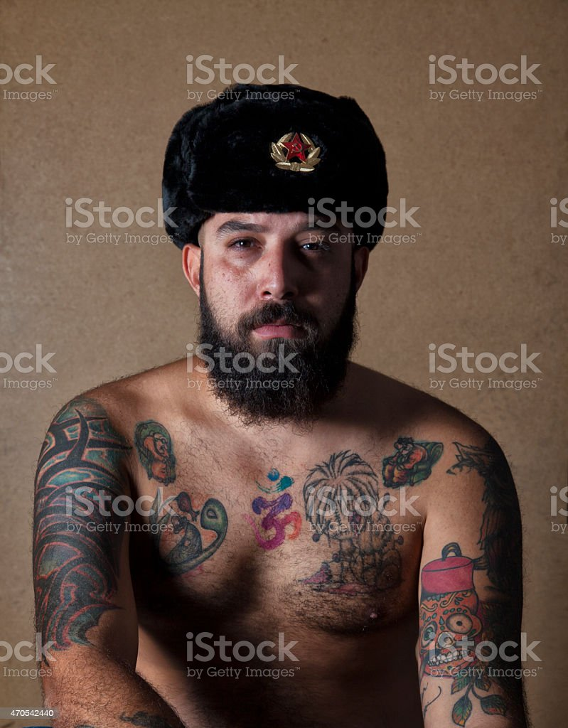 Tattooed Man Wearing Soviet Fur Hat stock photo