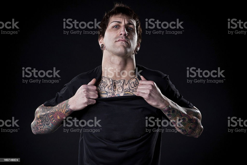 Tattooed man with serious expression. royalty-free stock photo