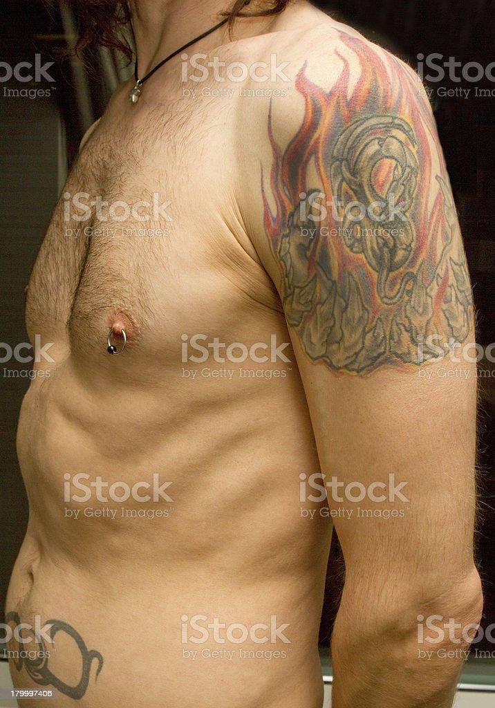 Tattooed Man's Arm and Torso stock photo