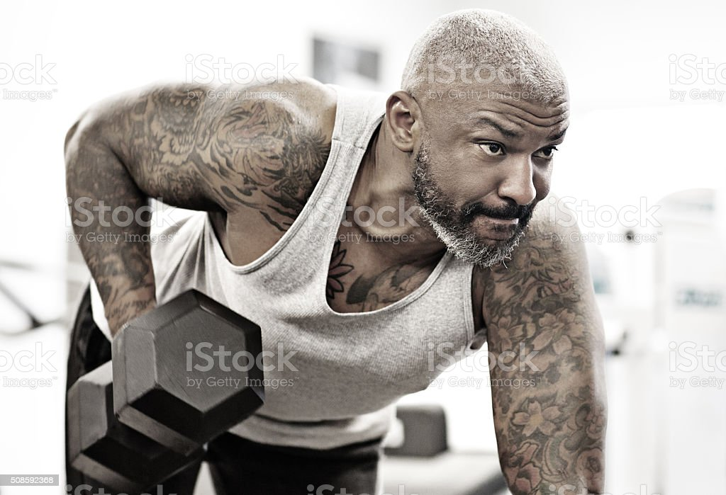 Tattooed middle aged bearded black man at a gym stock photo