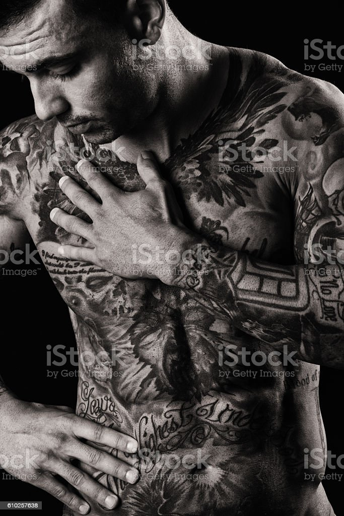 Tattooed Muscular Male Shirtless and Emotional stock photo