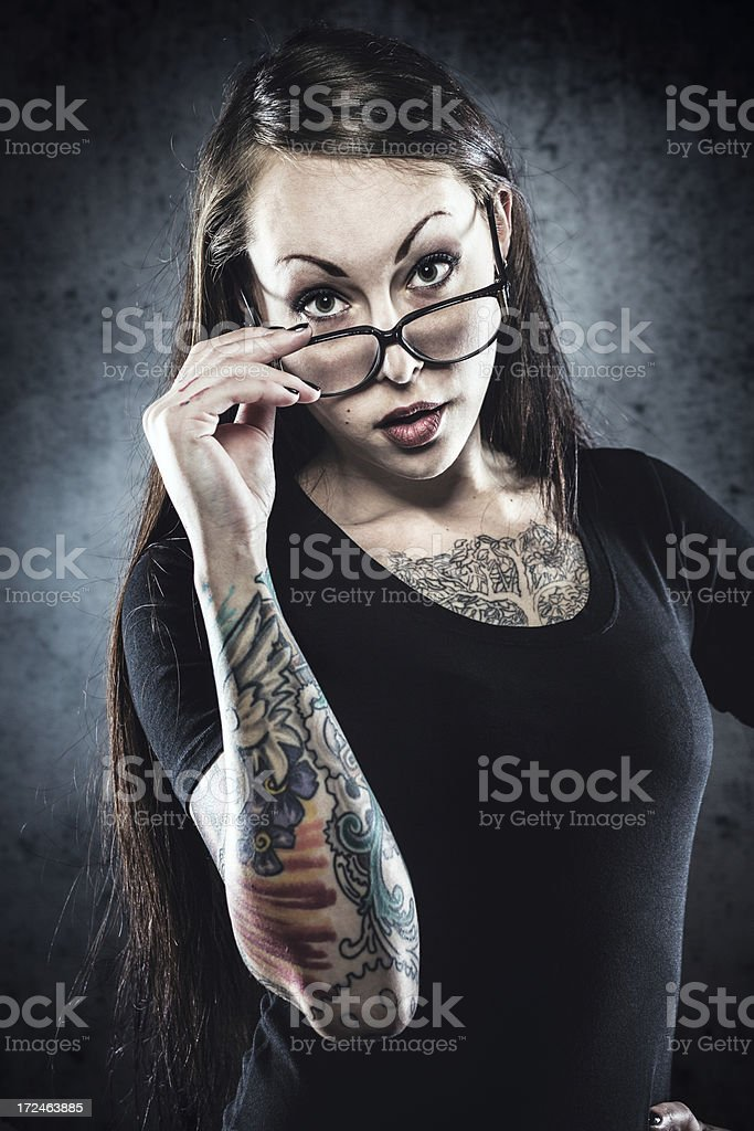 Tattooed Woman with Glasses royalty-free stock photo