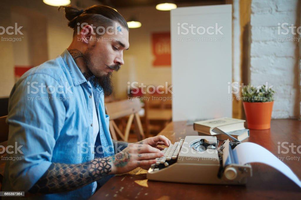 Side view portrait of stylish tattooed man using old-school vintage...
