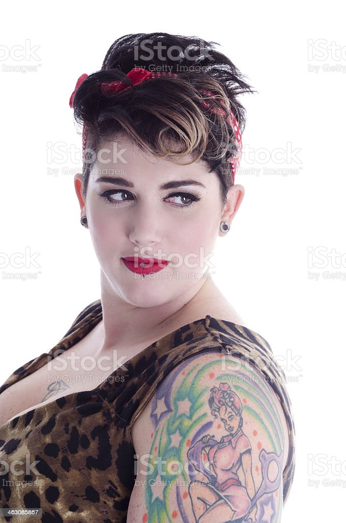 Tattooed young woman looking over shoulder. royalty-free stock photo