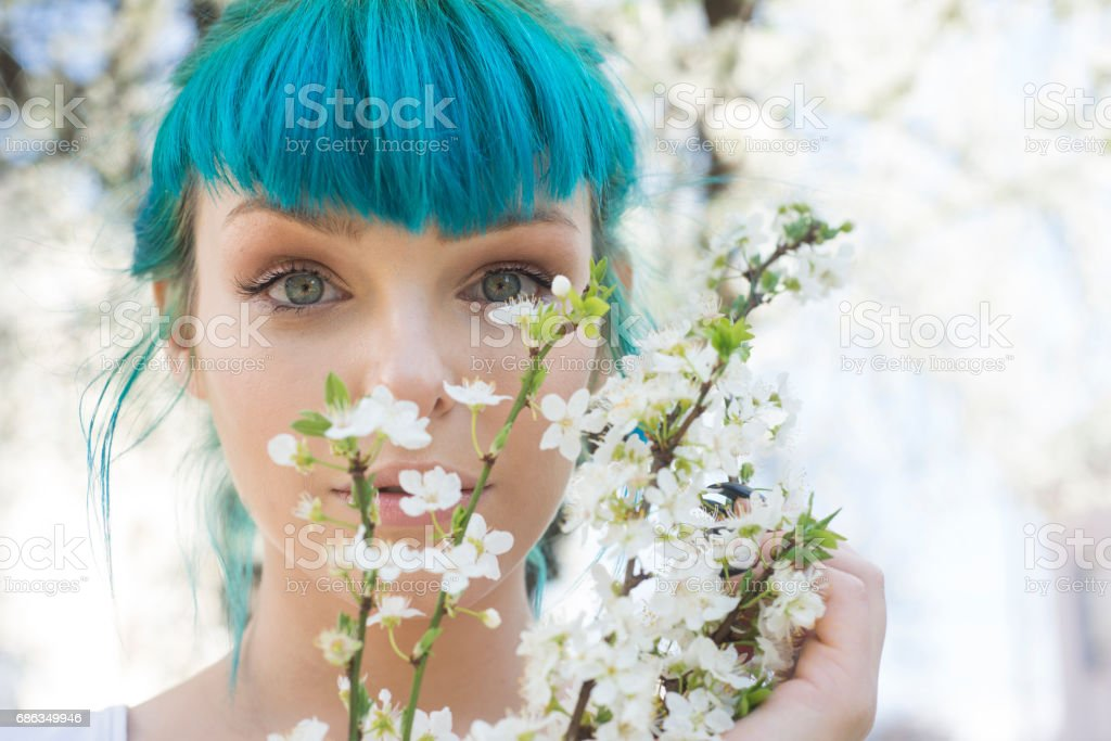 Tattooed young woman with flowers stock photo