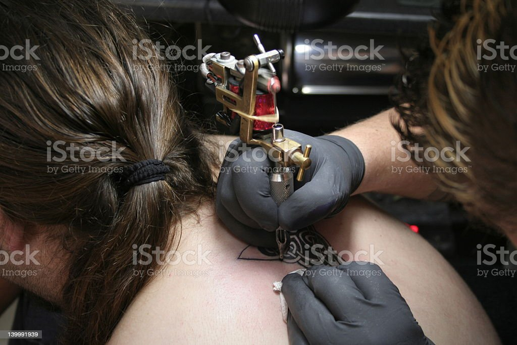 Tattooing stock photo