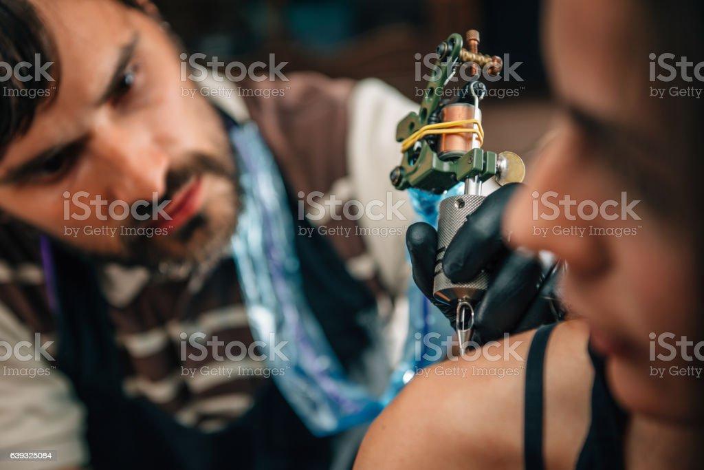 Tattooing stock photo