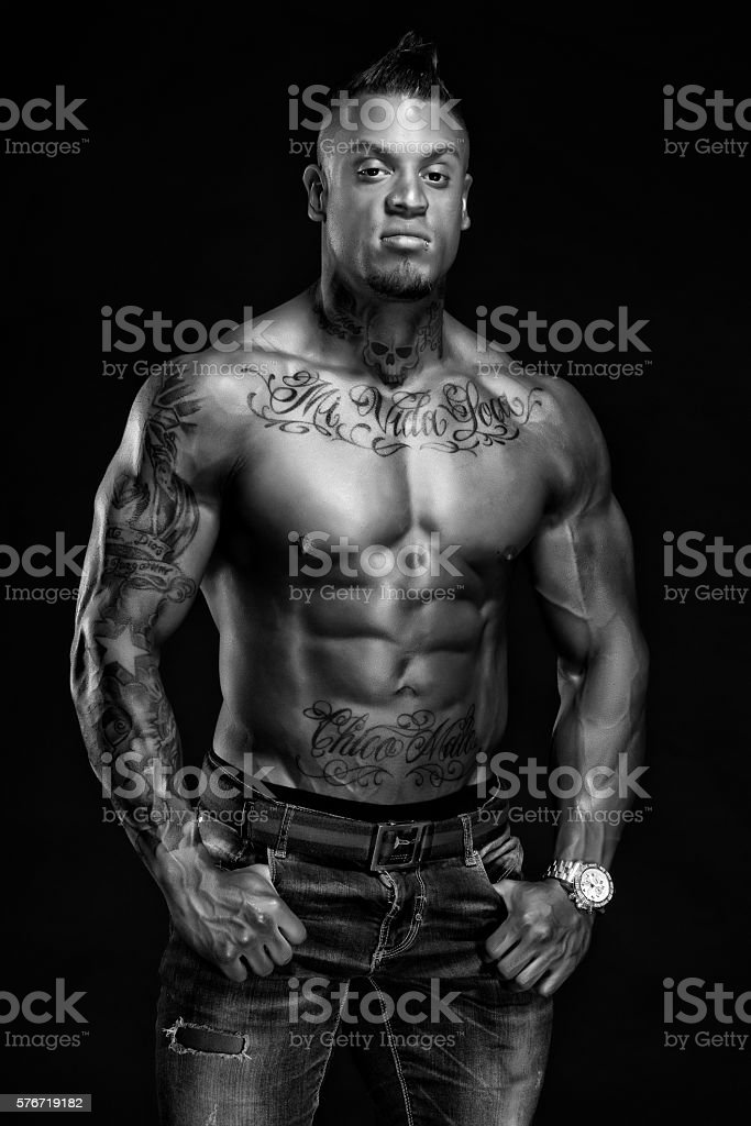 Tattoos and Muscles stock photo