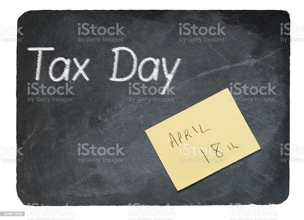 Tax Day concept using chalk on slate blackboard stock photo
