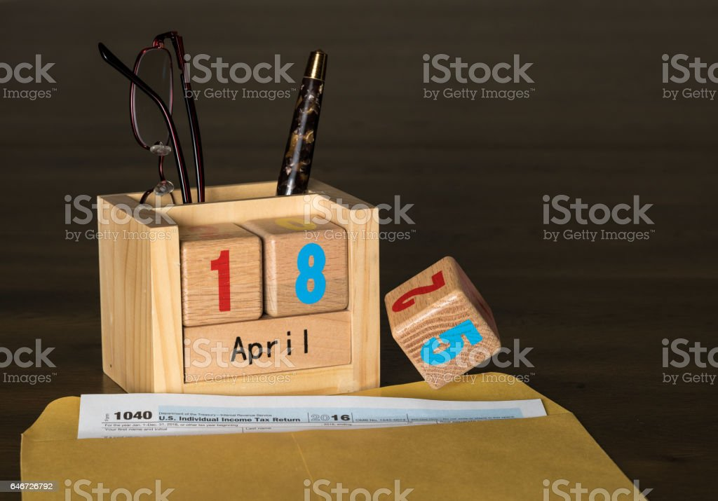 Tax day for 2016 returns is April 18, 2017 not 15th stock photo