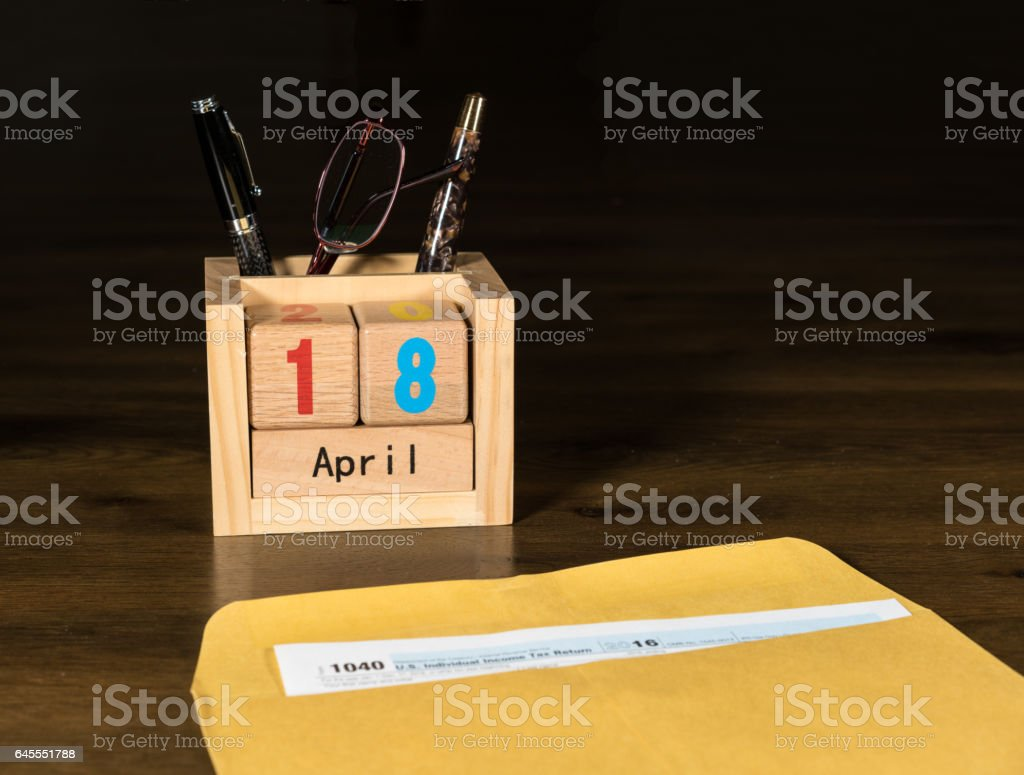 Tax day for 2016 returns is April 18, 2017 stock photo
