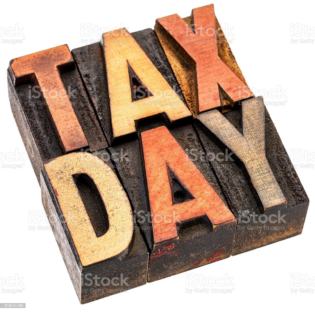 tax day in vintage wood type stock photo