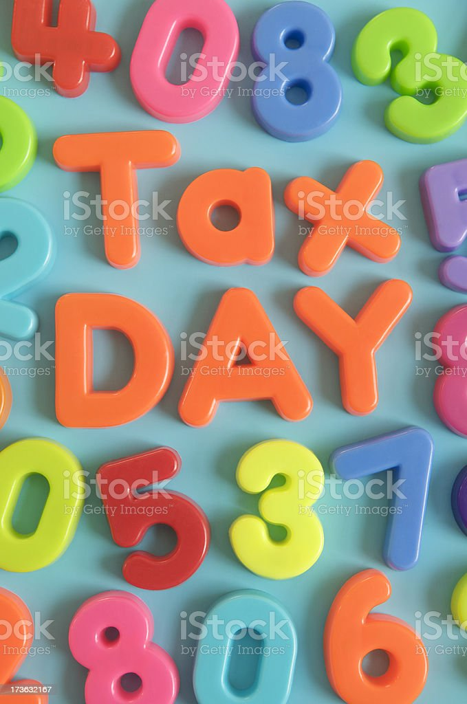 Tax Day Message with Colorful Letters and Numbers stock photo