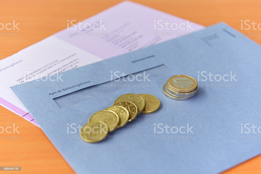 Tax declaration with envelope and Euro coins stock photo