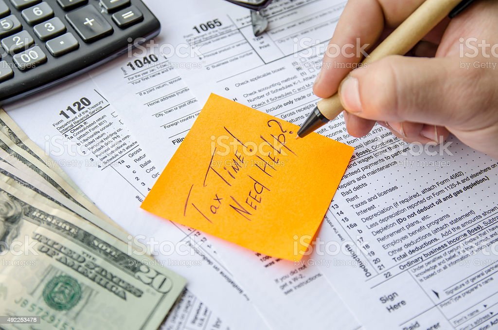 Tax form 1040, 1120, 1065  with pen, calculator and sticker stock photo
