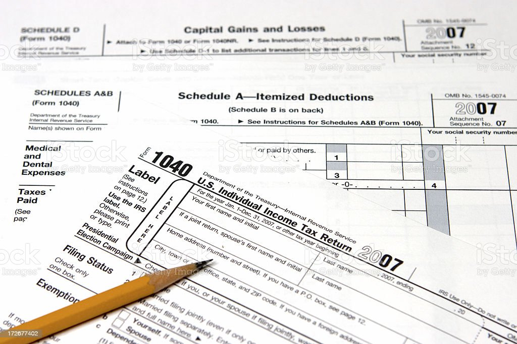 US Tax Form 1040 & Capital Gains and Losses stock photo