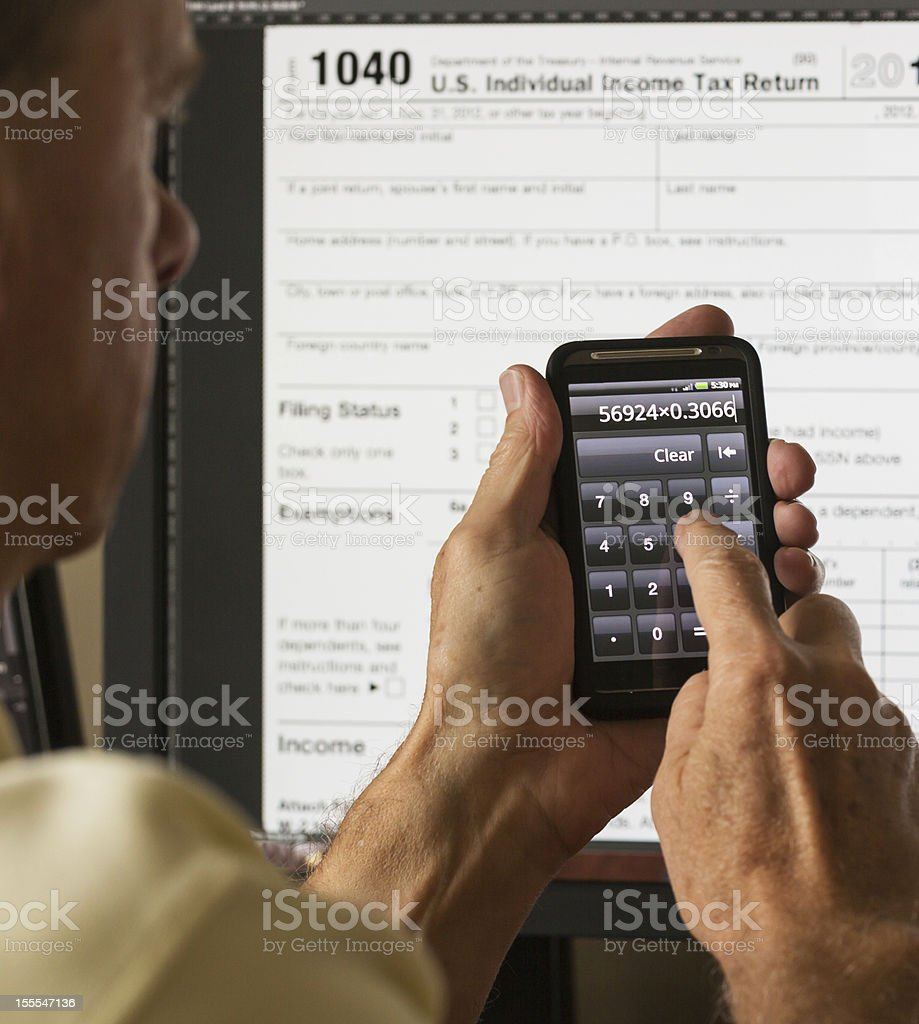 USA tax form 1040 for year 2012 and calculator royalty-free stock photo