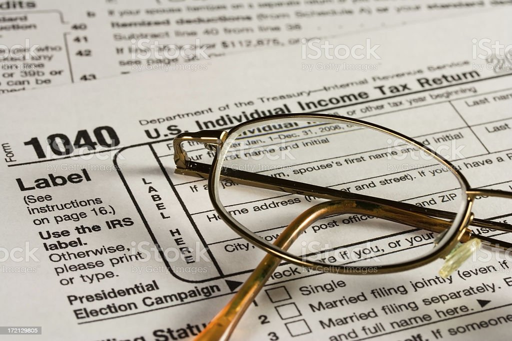 Tax Form 1040 with glasses stock photo
