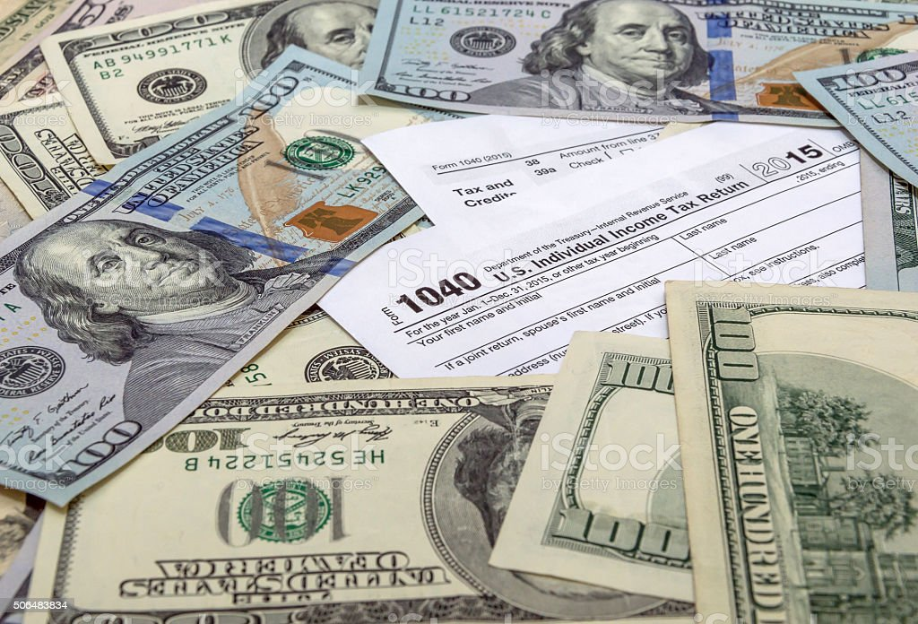 Tax form 1040 with US dollars stock photo
