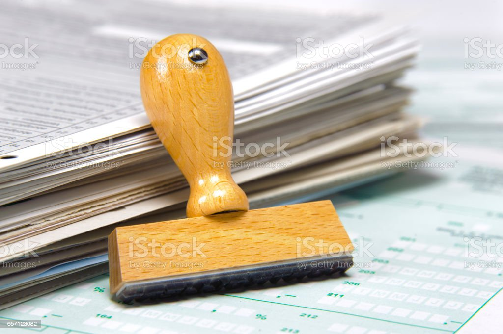 tax form and  blank rubber stamp is ready for your text stock photo