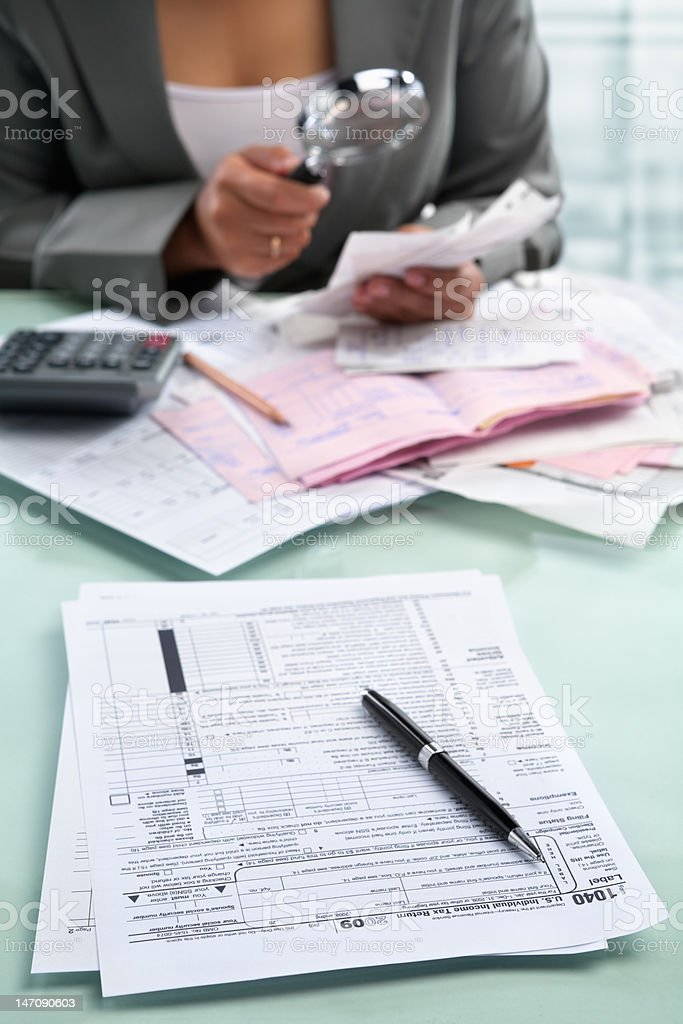 Tax form and businesswoman royalty-free stock photo