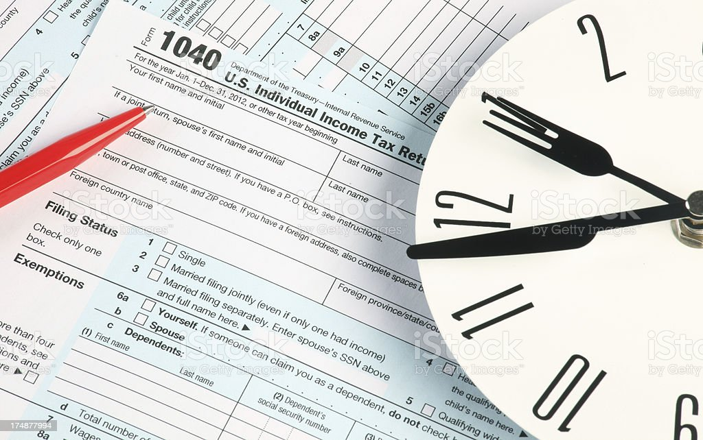 Tax form clock and pen royalty-free stock photo