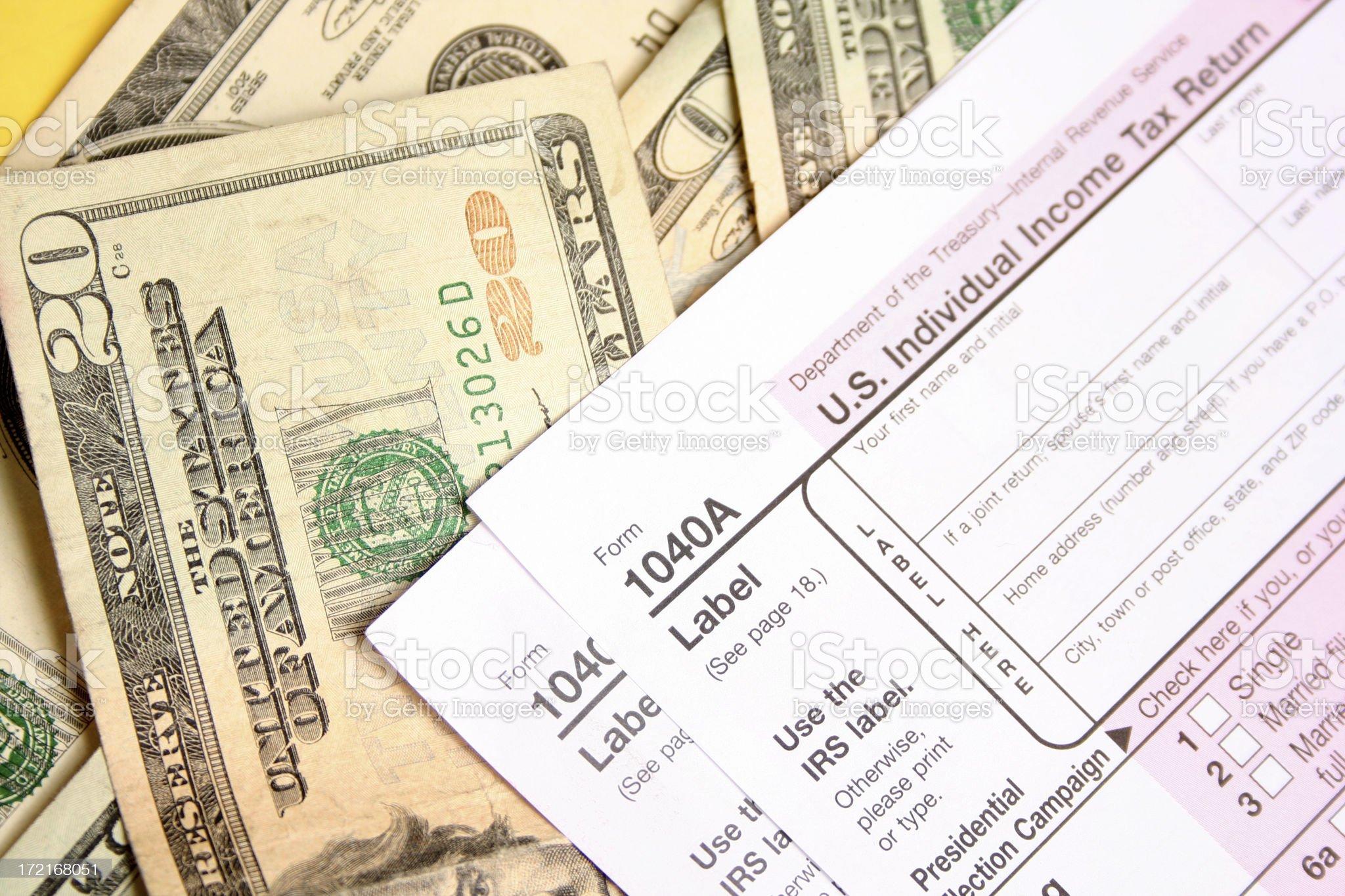 Tax Form on Money royalty-free stock photo