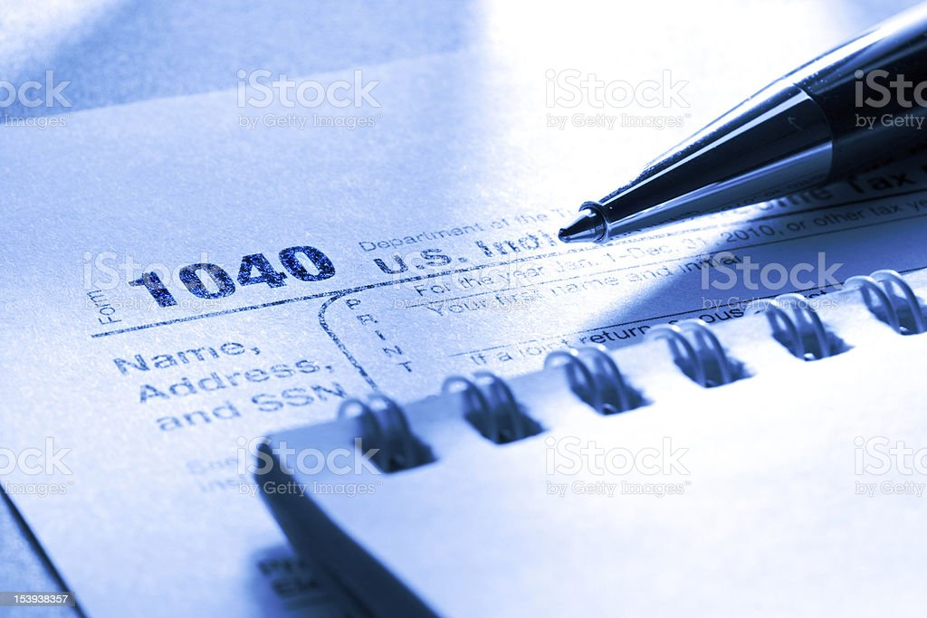 Tax form, pen and notepad royalty-free stock photo
