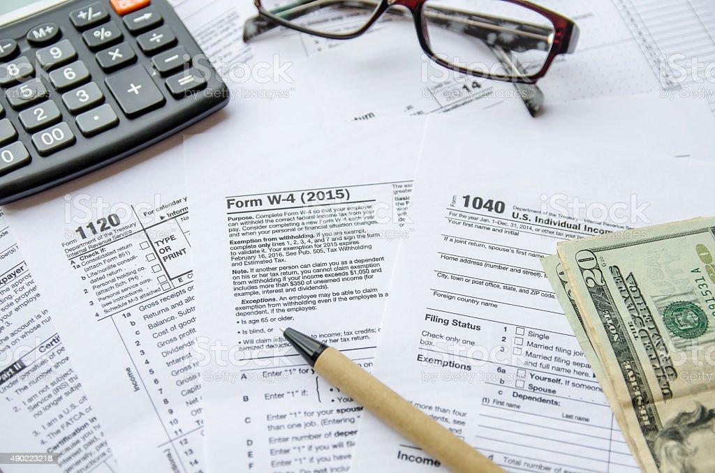 Tax Form W4, 1120, 1040 stock photo