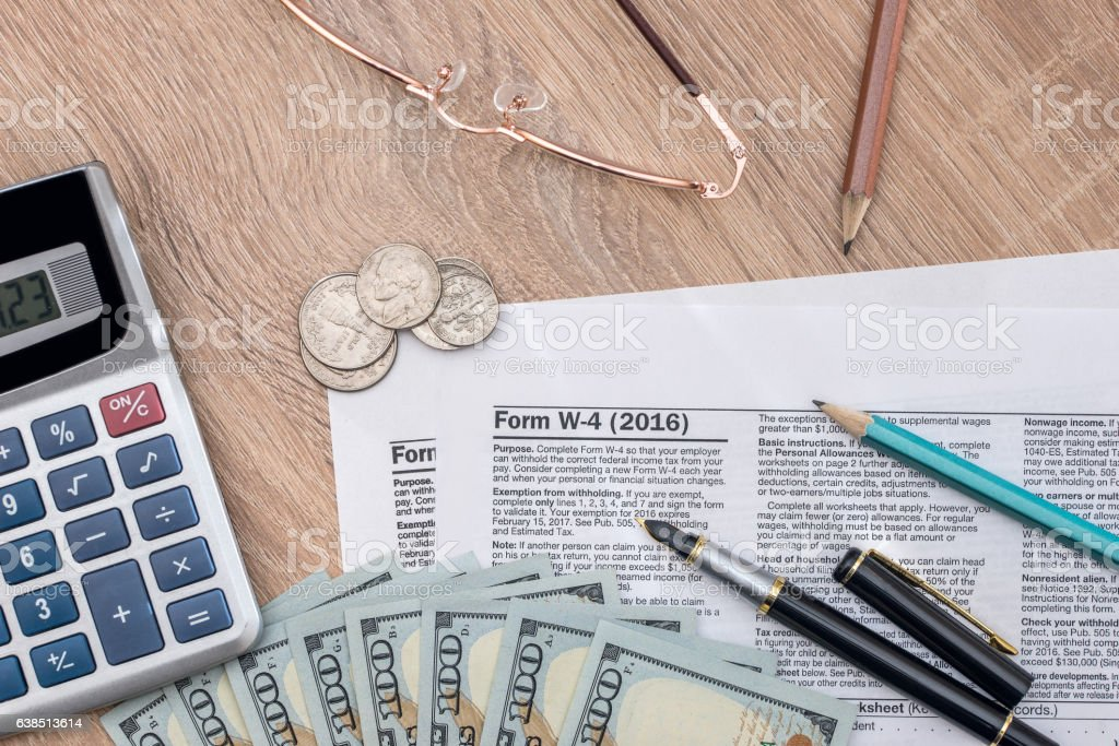 2017 tax form - w4 with money. stock photo