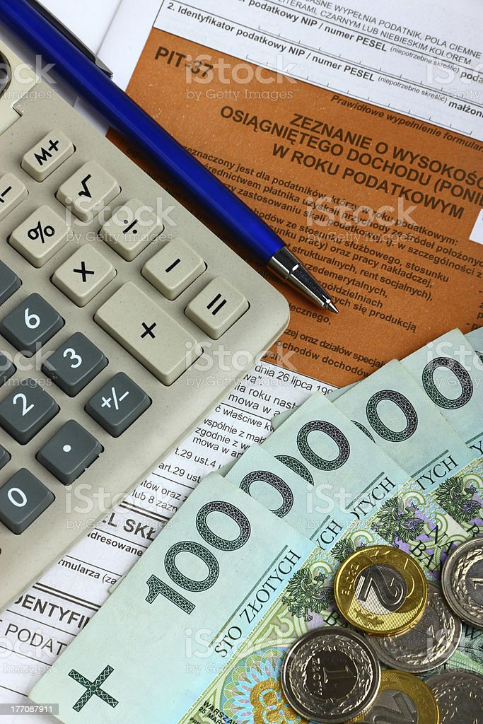 Tax form with calculator, money and pen royalty-free stock photo